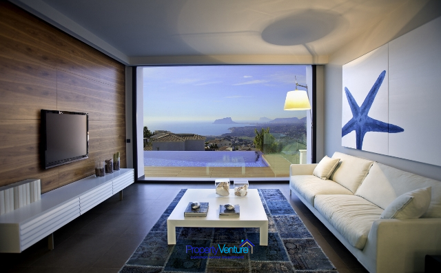 Commanding sun-sea-pool views from lounge
